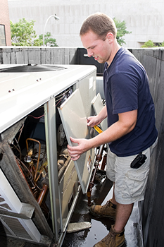 Photo of technician working on air unit